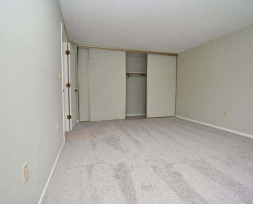 Bedroom Detail with accommodating closets at St. Clair Woods Apartments